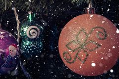 Christmas tree decorations on a branch in vintage style royalty free stock photos