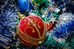 Christmas tree decorations. Christmas tree bright balls, tinsel and beads in blue and red Royalty Free Stock Photos