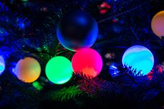 Christmas Tree Decorations. Colour baubles om tree Royalty Free Stock Photo