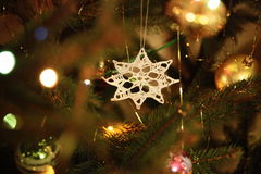 Christmas tree decorations. Close-up of Christmas decorations - balls, Christmas lights and handmade white woolen star stock images