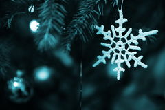 Christmas tree decorations. Close-up of Christmas tree decorations - handmade white woolen star, balls, Christmas lights Stock Photography