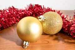 Christmas tree decorations, colorated balls on a wood table royalty free stock photos