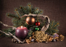 Christmas tree and decorations, decorated candles and driftwood. Royalty Free Stock Photography