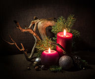 Christmas tree and decorations, decorated candles and driftwood. Royalty Free Stock Photo