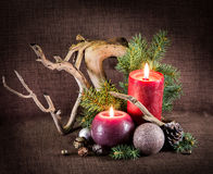 Christmas tree and decorations, decorated candles and driftwood. Stock Photos