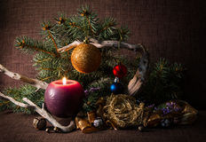 Christmas tree and decorations, decorated candles and driftwood. Stock Photo
