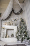 Christmas tree decorations and a fireplace Stock Photography
