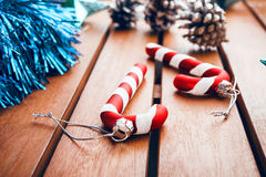 Christmas tree decorations in the form of candy cane on wooden t. Christmas candy cane on wooden table Stock Photos