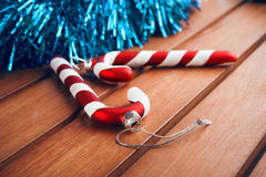 Christmas tree decorations in the form of candy cane on wooden table. Christmas candy cane on wooden table Royalty Free Stock Photography