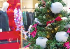 Christmas tree with decorations in the form of white apples royalty free stock images