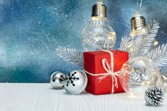Christmas tree decorations, gift box and retro light lamps Royalty Free Stock Photos
