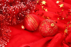 Christmas tree decorations. Glass balls on red fabric Royalty Free Stock Photography