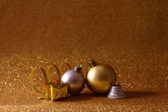 Christmas tree decorations on glitter background Royalty Free Stock Images