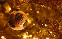 Christmas tree decorations with golden glow. royalty free stock photo
