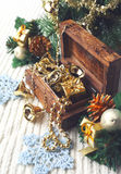 Christmas-tree decorations and goldish garland in carved wooden Royalty Free Stock Images