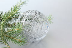 Christmas tree with decorations on gray Stock Photography