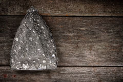 Christmas tree decorations on grunge wood background. Stock Photos