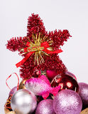 Christmas-tree decorations by a holiday. On a light background Stock Image