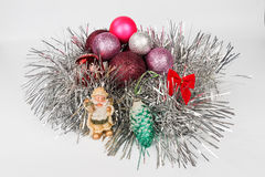 Christmas-tree decorations by a holiday. On a light background Stock Photos