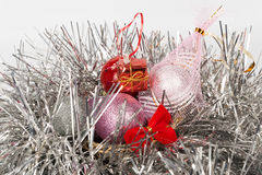 Christmas-tree decorations by a holiday. On a light background Royalty Free Stock Images
