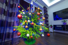 Christmas tree with decorations at home Royalty Free Stock Images