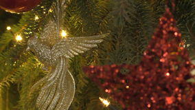 Christmas tree decorations, red star and golden bird stock video
