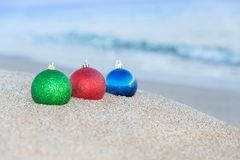 Christmas tree decorations on sea beach background Royalty Free Stock Photo