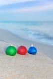 Christmas tree decorations on sea coast Royalty Free Stock Photos
