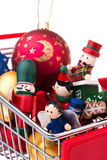 Christmas-tree decorations in a shopping cart Royalty Free Stock Images