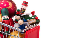 Christmas-tree decorations in a shopping cart Stock Photos