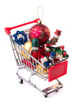 Christmas-tree decorations in a shopping cart Royalty Free Stock Photography
