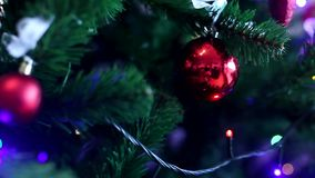 Christmas tree decorations. Sliding cinematic shots of Christmas tree decorations