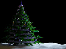 Christmas tree with decorations and snow on isolate black Stock Photo