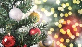 Christmas tree with decorations and snowflake on bokeh. Background. for Happy New Year 2018 Royalty Free Stock Photography
