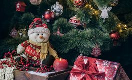 Christmas tree with decorations and snowman stock photo