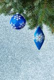 Christmas tree decorations on a spruce branch Royalty Free Stock Photo