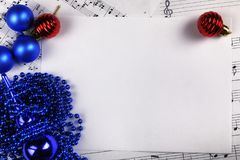 Christmas tree decorations on the table and sheet with music not Stock Image