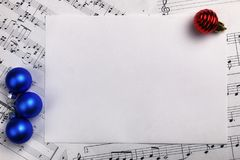 Christmas tree decorations on the table and sheet with music not. New year composition Christmas tree decorations on the table and sheet with music notes stock photo