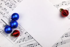 Christmas tree decorations on the table and sheet with music not Royalty Free Stock Photos