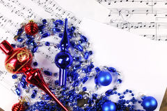 Christmas tree decorations on the table and sheet with music not Stock Images