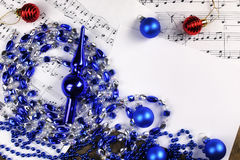Christmas tree decorations on the table and sheet with music not Royalty Free Stock Image