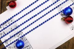 Christmas tree decorations on the table and sheet with music not Royalty Free Stock Images
