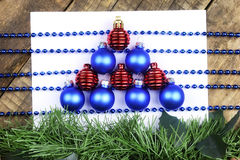 Christmas tree decorations on the table and sheet with music not Royalty Free Stock Photography