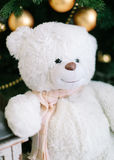 Christmas tree decorations. Toy bear near a cristmas tree. Royalty Free Stock Photos