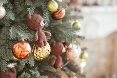 Christmas tree decorations. Toy knitted bear and vintage balls on cristmas tree. Close up shot. Clear space for text Stock Images