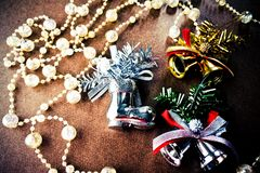 Christmas tree decorations, twinkle crystal beads, silver and golden bell, silver shoes. stock photo