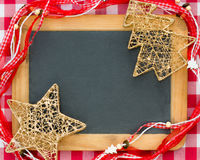 Christmas tree decorations on vintage wooden blackboard Stock Photo