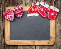 Christmas tree decorations on vintage wooden blackboard Stock Photos