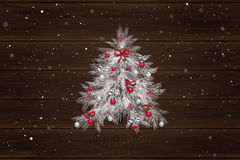 Christmas tree with decorations on the wood background. Christmas tree with decorations: balls, ribbons, stars and abstract elements. Wood background. White and Stock Photo