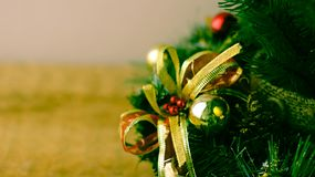Christmas tree and decorations on wooden background.